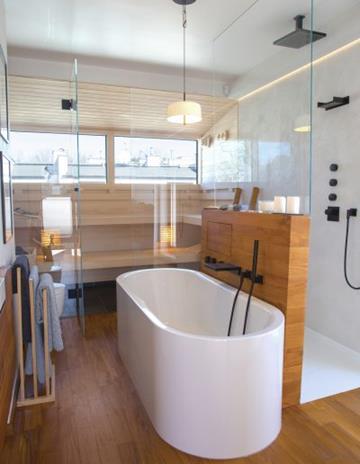 Dyskretne przeszkelnie pomiędzy prysznicem a resztą pomieszczenia.