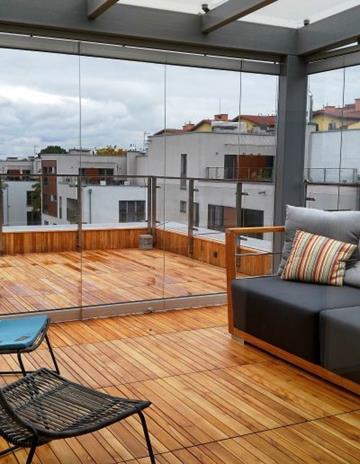 Ogród zimowy na tarasie apartamentowca. Autorski projekt konstrukcji stalowej.